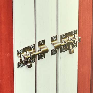 Closeup of metal latches on doors, locked in place