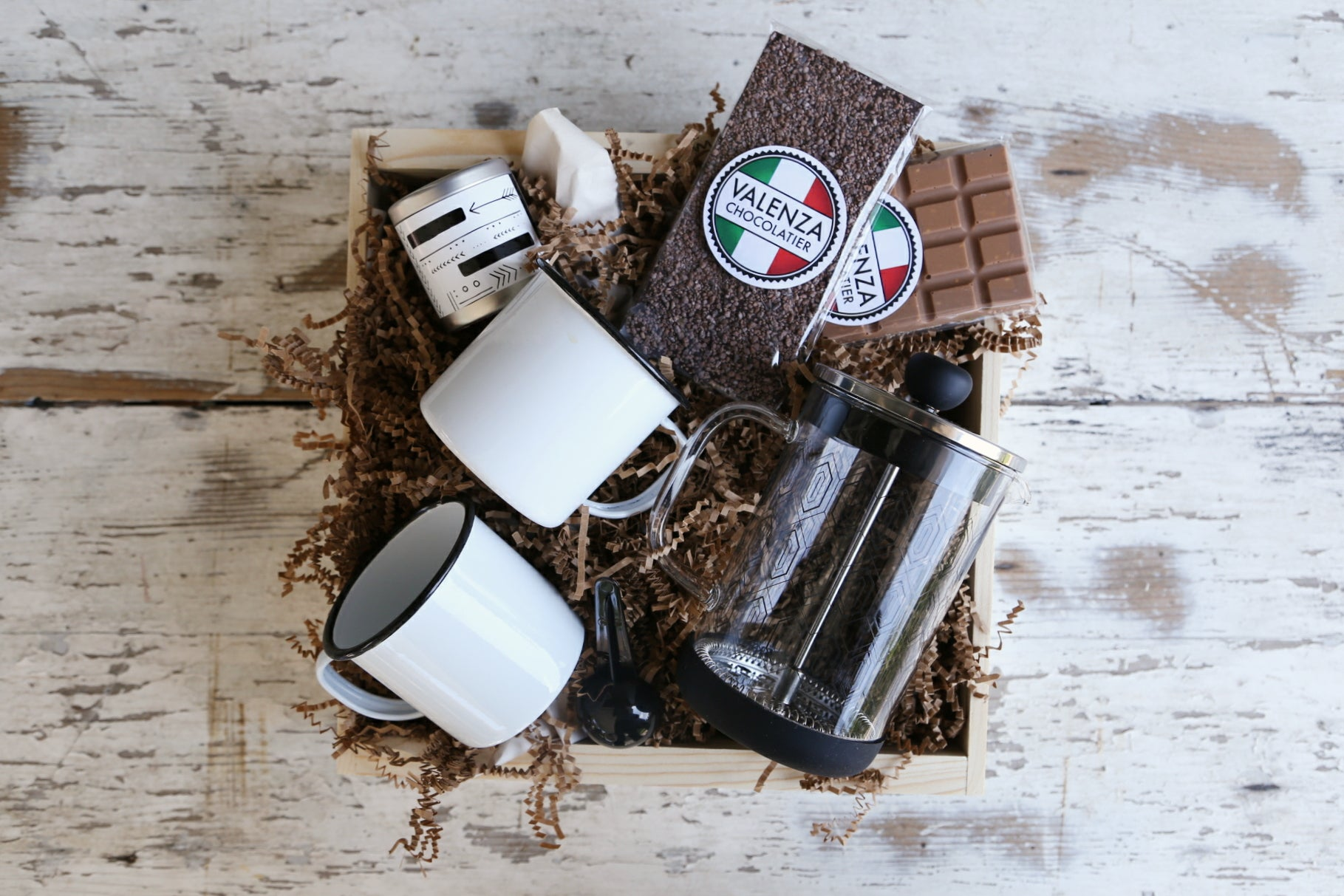 Chocolate & French Press: this gift features a designer glass french press, two bars of rich Valenza chocolate, two enamel mugs & a candle tin. $65