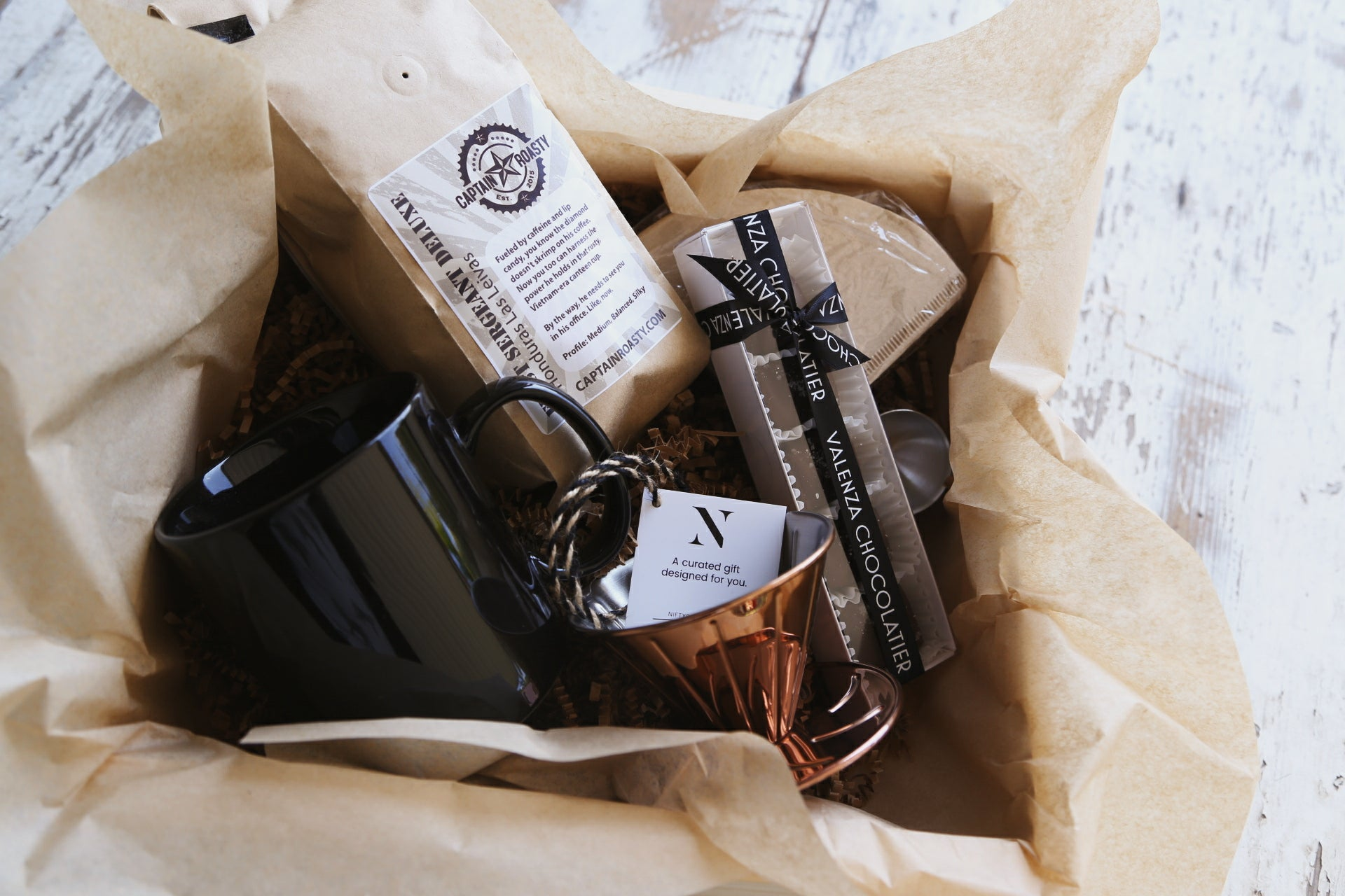 Caramels & Pour Over: this modern set contains decadent Valenza salted caramels, veteran-owned Captain Roasty coffee, sleek mug & copper pour over kit complete with filters & measure. $65