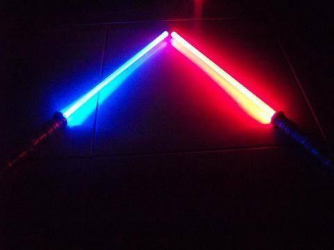 TotalFx Rouge Lightsabers. Includes 2