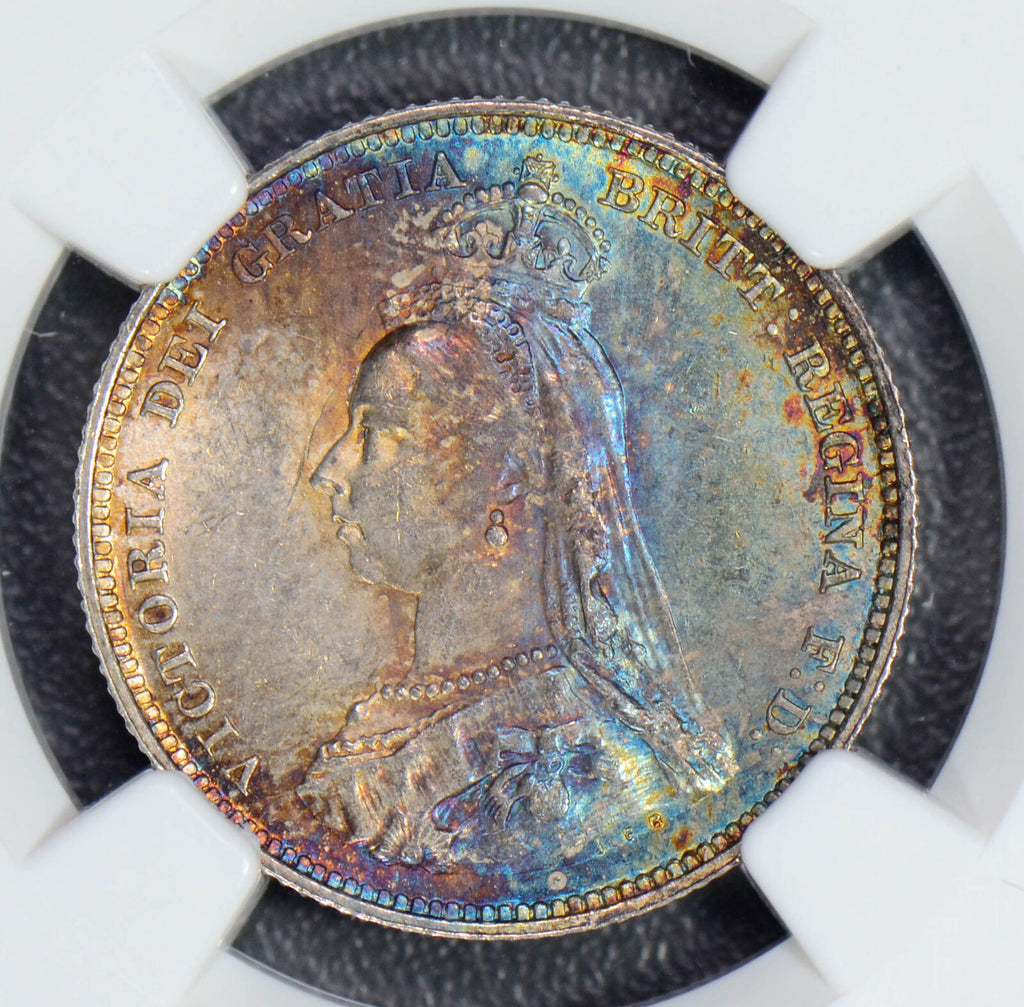 Great Britain 1887 Shilling silver gorgeous purple blue and golden toning NG0440