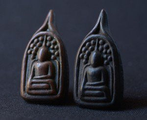 Two solid iron Somdej Toh Amulets - brown and black.