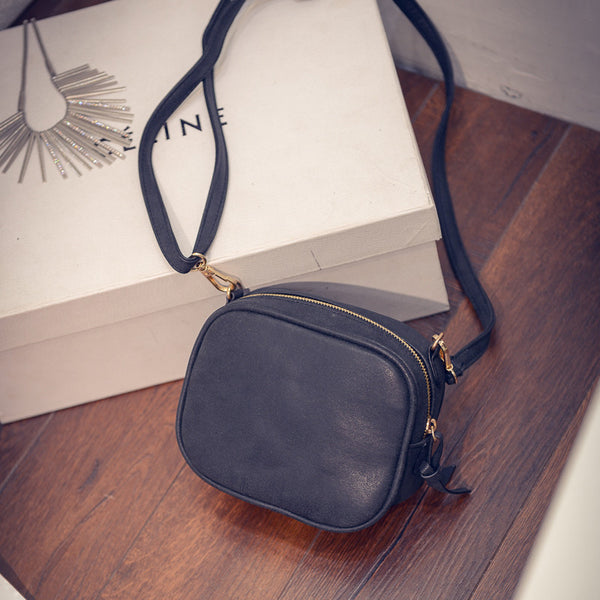 Yael PU leather cross-body bag