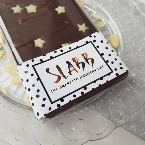 The Marzipan Amaretto One | Vegan | 12 Weeks Of Christmas - The Home Of Fully Loaded boozy Chocolate. Large Slabbs of boozy chocolate with a variety of alcoholic ganaches; gin, rum, whisky, amaretto, baileys and toppings. Available as monthly subscriptions.