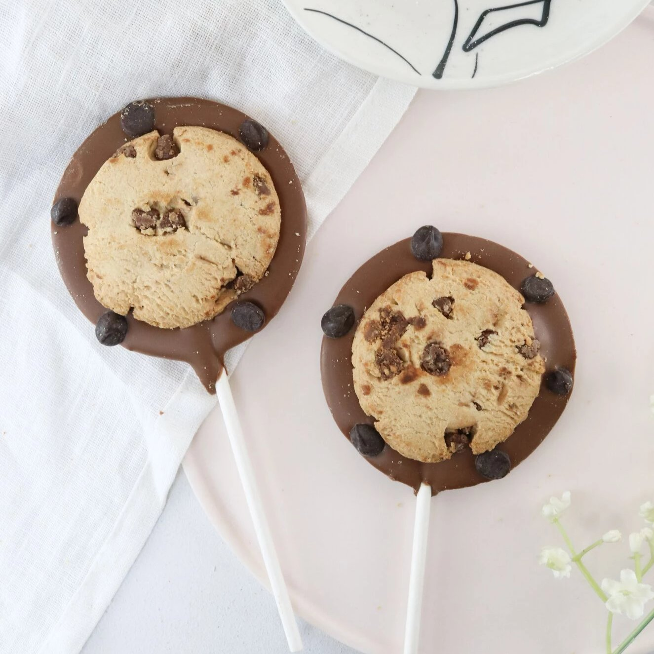 Milk Chocolate Cookie Lollipop - The Home Of Fully Loaded boozy Chocolate. Large Slabbs of boozy chocolate with a variety of alcoholic ganaches; gin, rum, whisky, amaretto, baileys and toppings. Available as monthly subscriptions.