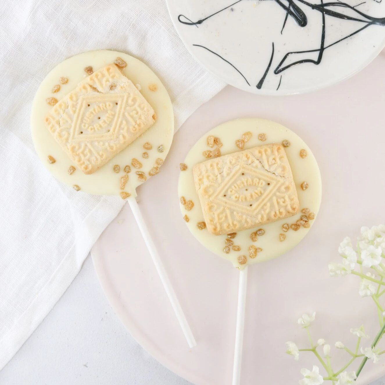 White Chocolate Custard Cream Lollipop - The Home Of Fully Loaded boozy Chocolate. Large Slabbs of boozy chocolate with a variety of alcoholic ganaches; gin, rum, whisky, amaretto, baileys and toppings. Available as monthly subscriptions.