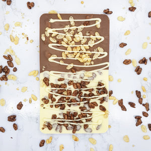 The Coco Pops Duo One - The Home Of Fully Loaded boozy Chocolate. Large Slabbs of boozy chocolate with a variety of alcoholic ganaches; gin, rum, whisky, amaretto, baileys and toppings. Available as monthly subscriptions.