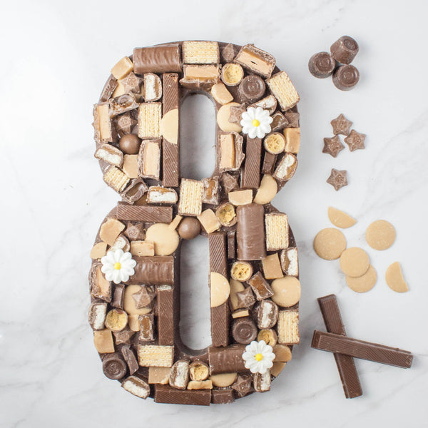 Giant Milk Chocolate 'Caramel Crush' Number - The Home Of Fully Loaded boozy Chocolate. Large Slabbs of boozy chocolate with a variety of alcoholic ganaches; gin, rum, whisky, amaretto, baileys and toppings. Available as monthly subscriptions.