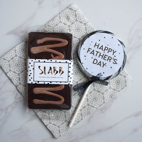 Father's Day Whiskey Chocolate & Giant Lollipop Set - The Home Of Fully Loaded boozy Chocolate. Large Slabbs of boozy chocolate with a variety of alcoholic ganaches; gin, rum, whisky, amaretto, baileys and toppings. Available as monthly subscriptions.