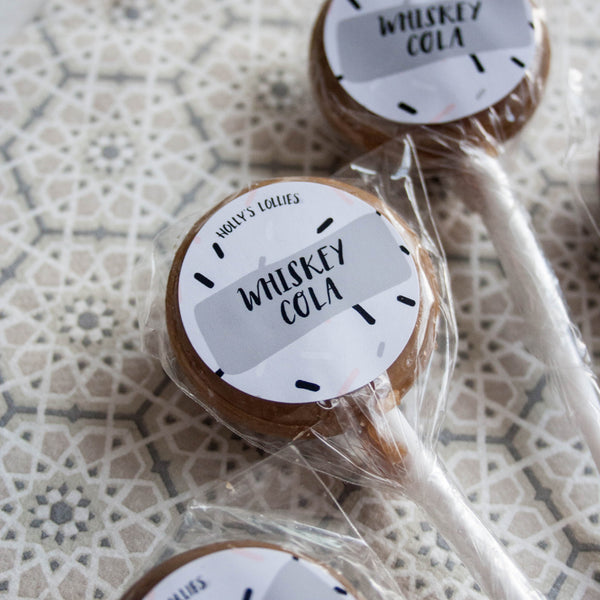 Whiskey Chocolate & Lollipop Set - The Home Of Fully Loaded boozy Chocolate. Large Slabbs of boozy chocolate with a variety of alcoholic ganaches; gin, rum, whisky, amaretto, baileys and toppings. Available as monthly subscriptions.