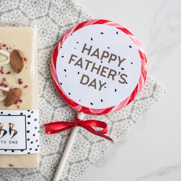 Father's Day Amaretto Chocolate & Giant Lollipop Set - The Home Of Fully Loaded boozy Chocolate. Large Slabbs of boozy chocolate with a variety of alcoholic ganaches; gin, rum, whisky, amaretto, baileys and toppings. Available as monthly subscriptions.