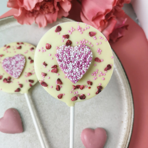 Pink Strawberry Heart Lollipop - The Home Of Fully Loaded boozy Chocolate. Large Slabbs of boozy chocolate with a variety of alcoholic ganaches; gin, rum, whisky, amaretto, baileys and toppings. Available as monthly subscriptions.