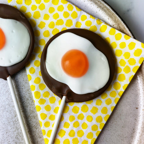 Milk Chocolate Jelly Egg Lollipop - The Home Of Fully Loaded boozy Chocolate. Large Slabbs of boozy chocolate with a variety of alcoholic ganaches; gin, rum, whisky, amaretto, baileys and toppings. Available as monthly subscriptions.