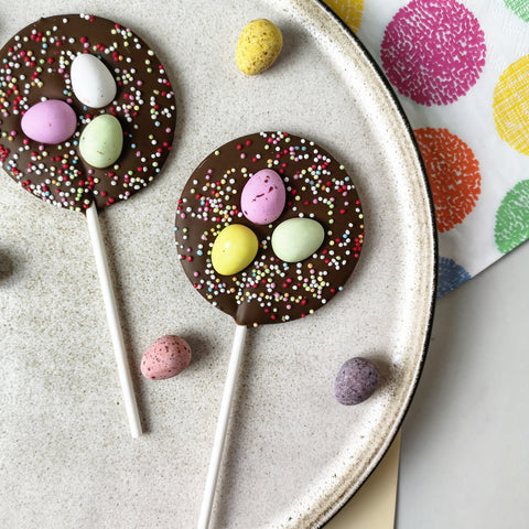Milk Chocolate Mini Egg Easter Lollipop - The Home Of Fully Loaded boozy Chocolate. Large Slabbs of boozy chocolate with a variety of alcoholic ganaches; gin, rum, whisky, amaretto, baileys and toppings. Available as monthly subscriptions.