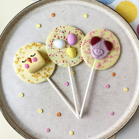 Three White Chocolate Easter Lollipops Collection - The Home Of Fully Loaded boozy Chocolate. Large Slabbs of boozy chocolate with a variety of alcoholic ganaches; gin, rum, whisky, amaretto, baileys and toppings. Available as monthly subscriptions.