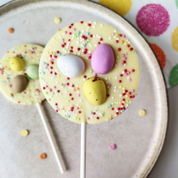 White Chocolate Mini Egg Easter Lollipop - The Home Of Fully Loaded boozy Chocolate. Large Slabbs of boozy chocolate with a variety of alcoholic ganaches; gin, rum, whisky, amaretto, baileys and toppings. Available as monthly subscriptions.