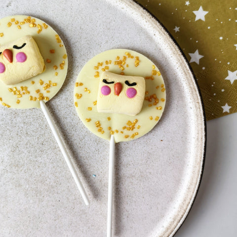 White Chocolate Chick Easter Lollipop - The Home Of Fully Loaded boozy Chocolate. Large Slabbs of boozy chocolate with a variety of alcoholic ganaches; gin, rum, whisky, amaretto, baileys and toppings. Available as monthly subscriptions.