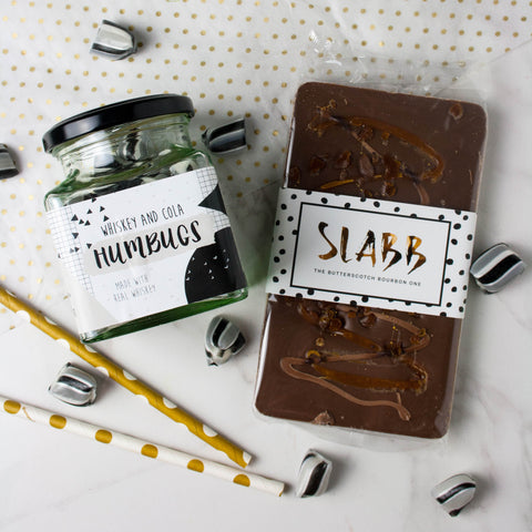 Whiskey Lover's Sweets and Chocolate Set - The Home Of Fully Loaded boozy Chocolate. Large Slabbs of boozy chocolate with a variety of alcoholic ganaches; gin, rum, whisky, amaretto, baileys and toppings. Available as monthly subscriptions.