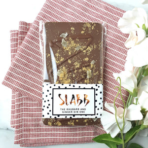 The Rhubarb and Ginger Gin One - The Home Of Fully Loaded boozy Chocolate. Large Slabbs of boozy chocolate with a variety of alcoholic ganaches; gin, rum, whisky, amaretto, baileys and toppings. Available as monthly subscriptions.