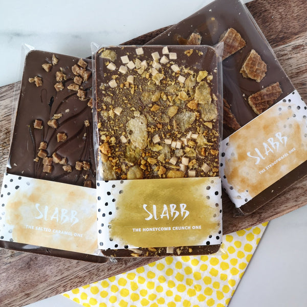 Caramel Chocolate Trio - The Home Of Fully Loaded boozy Chocolate. Large Slabbs of boozy chocolate with a variety of alcoholic ganaches; gin, rum, whisky, amaretto, baileys and toppings. Available as monthly subscriptions.
