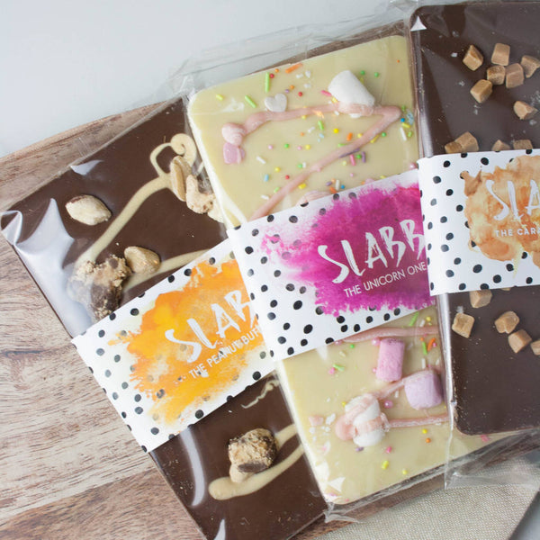 Kids Non Alcoholic Chocolate Slabb Collection - The Home Of Fully Loaded boozy Chocolate. Large Slabbs of boozy chocolate with a variety of alcoholic ganaches; gin, rum, whisky, amaretto, baileys and toppings. Available as monthly subscriptions.