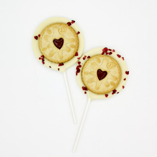 White Chocolate Jammy Dodger Lollipop - The Home Of Fully Loaded boozy Chocolate. Large Slabbs of boozy chocolate with a variety of alcoholic ganaches; gin, rum, whisky, amaretto, baileys and toppings. Available as monthly subscriptions.