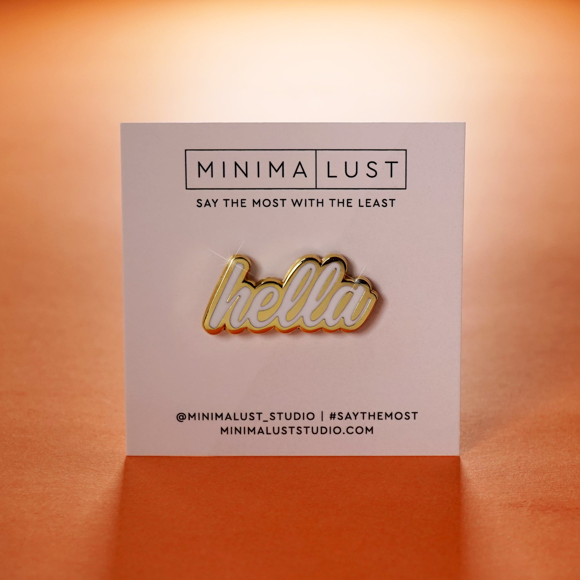 Hella White & Gold Enamel Pin