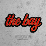 The Bay Red & Gold Die Cut Sticker