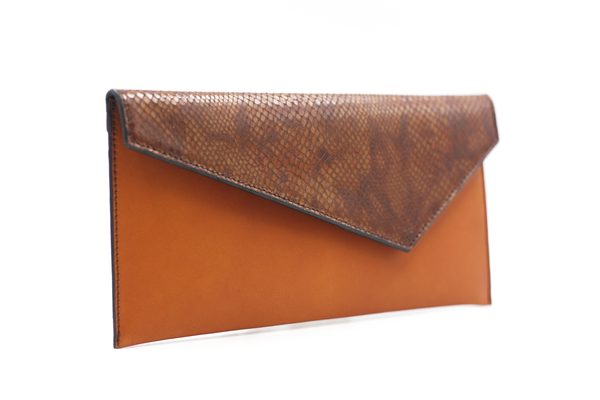Cognac clutch with fauve flap michael guerisse oleary brussels concept store two