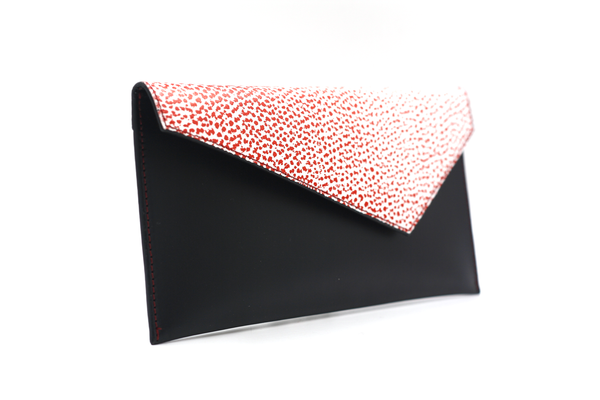 black clutch with red and white flap michael guerisse oleary brussels concept store two