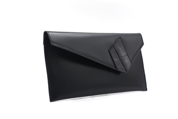 black clutch with stripes michael guerisse oleary brussels concept store two