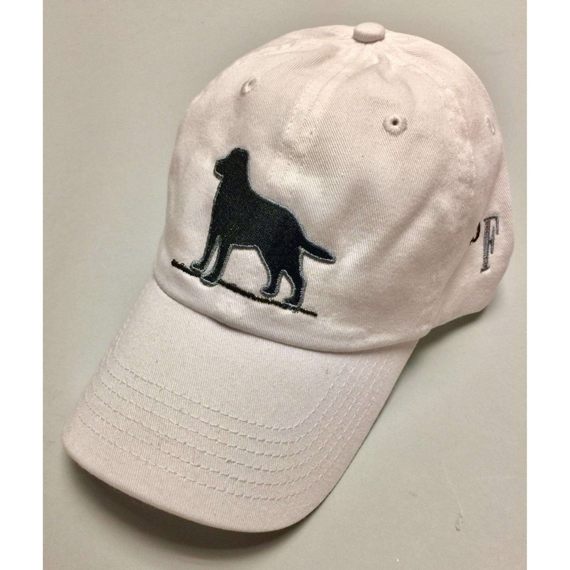 Black Labrador Retriever on a White Hat
