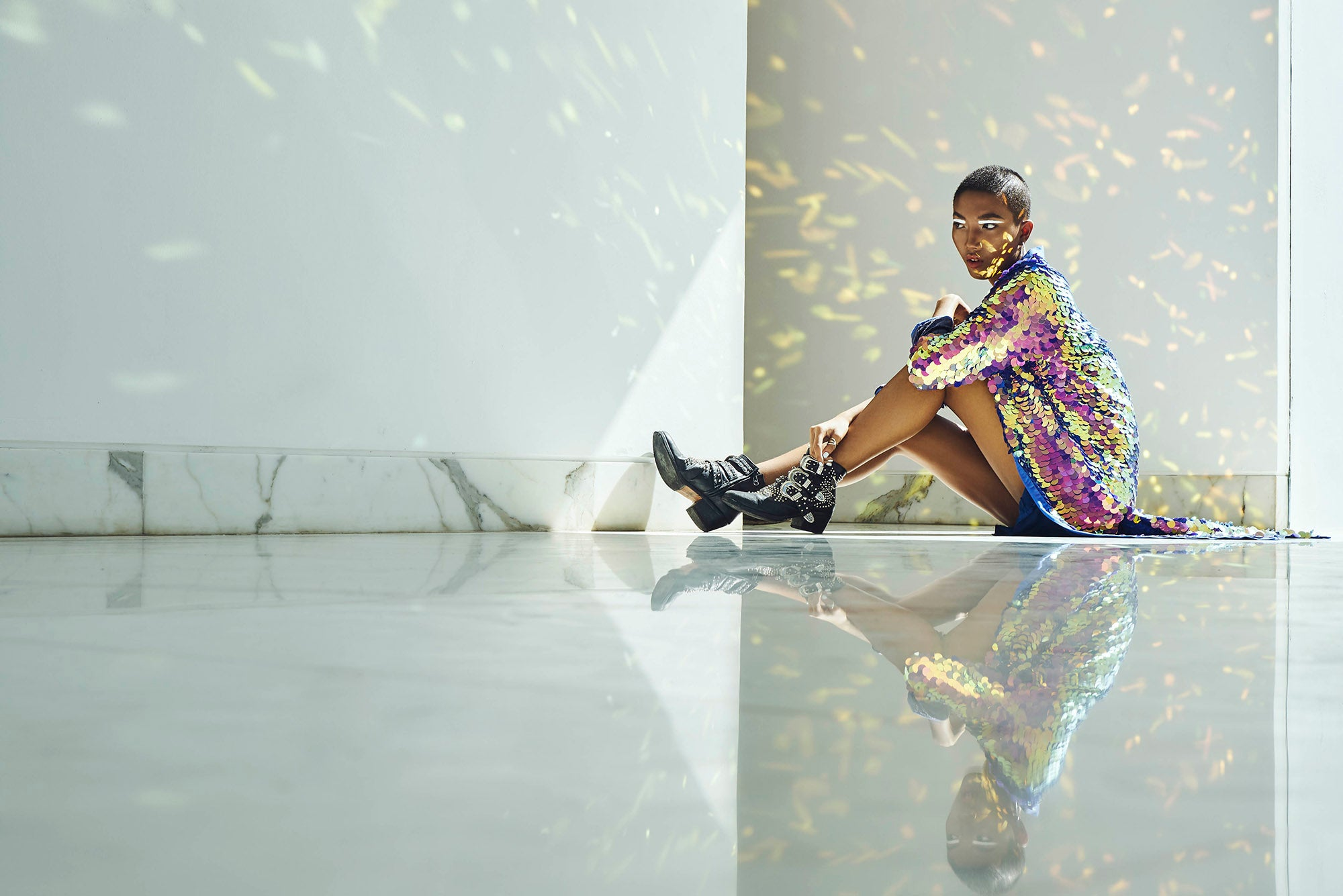 "woman wearing a long sequin kimono in the colour purple sitting in a white room"" /></div><img src="
