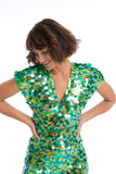 Close up of model wearing Aphrodite sequin Jumpsuit in Amazon image 2