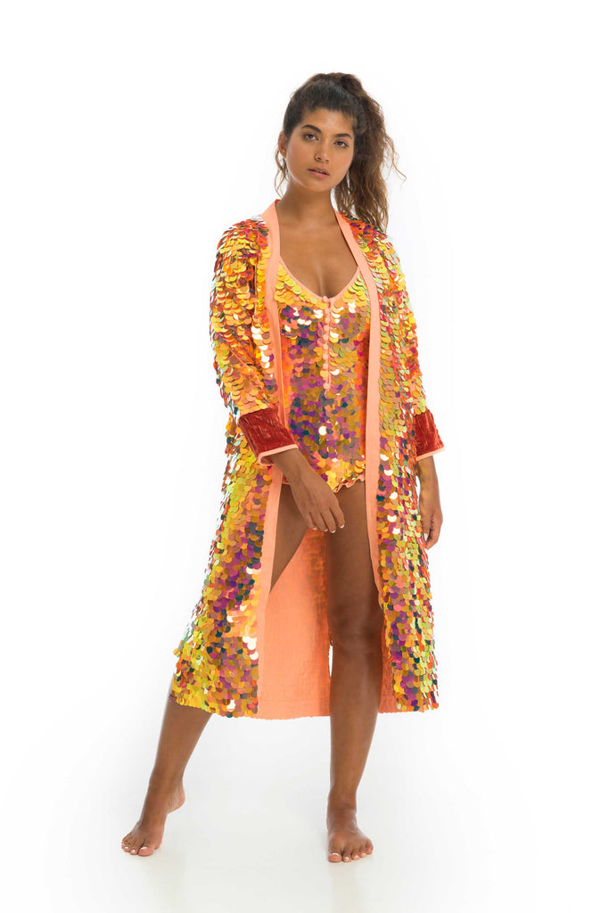 rosa bloom orange pink solar coloured sequin long coat with red silk velvet cuffs
