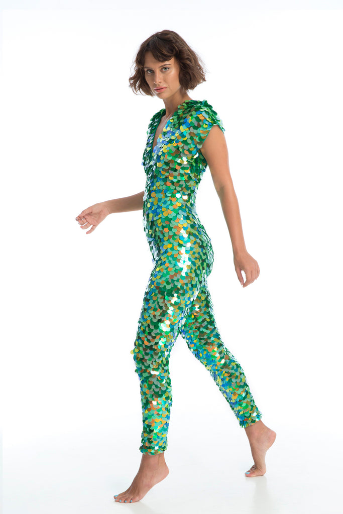 Model steps to right wearing Aphrodite Jumpsuit in Amazon image 1