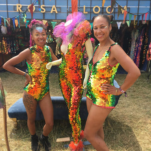 Festival goers wearinf sequin leotards pose with a mannequin