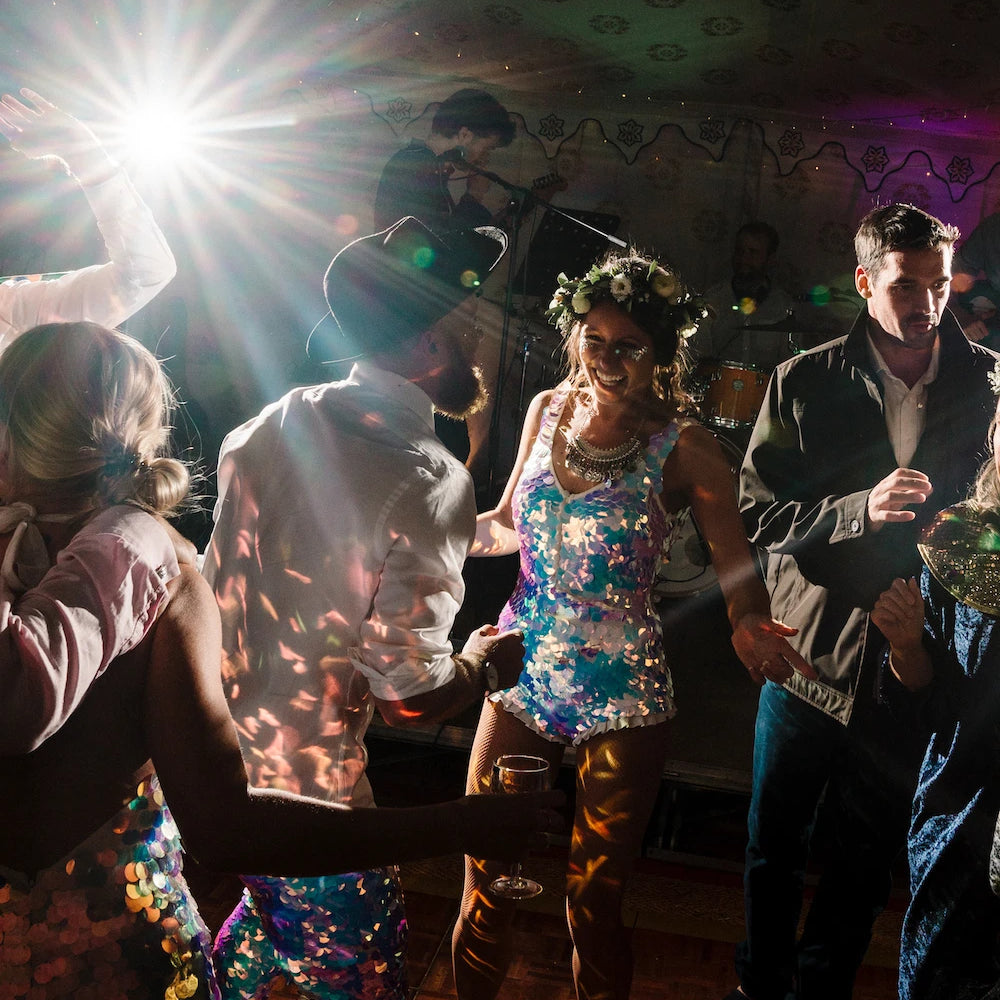 A bride and groom wear sequins to their festival wedding