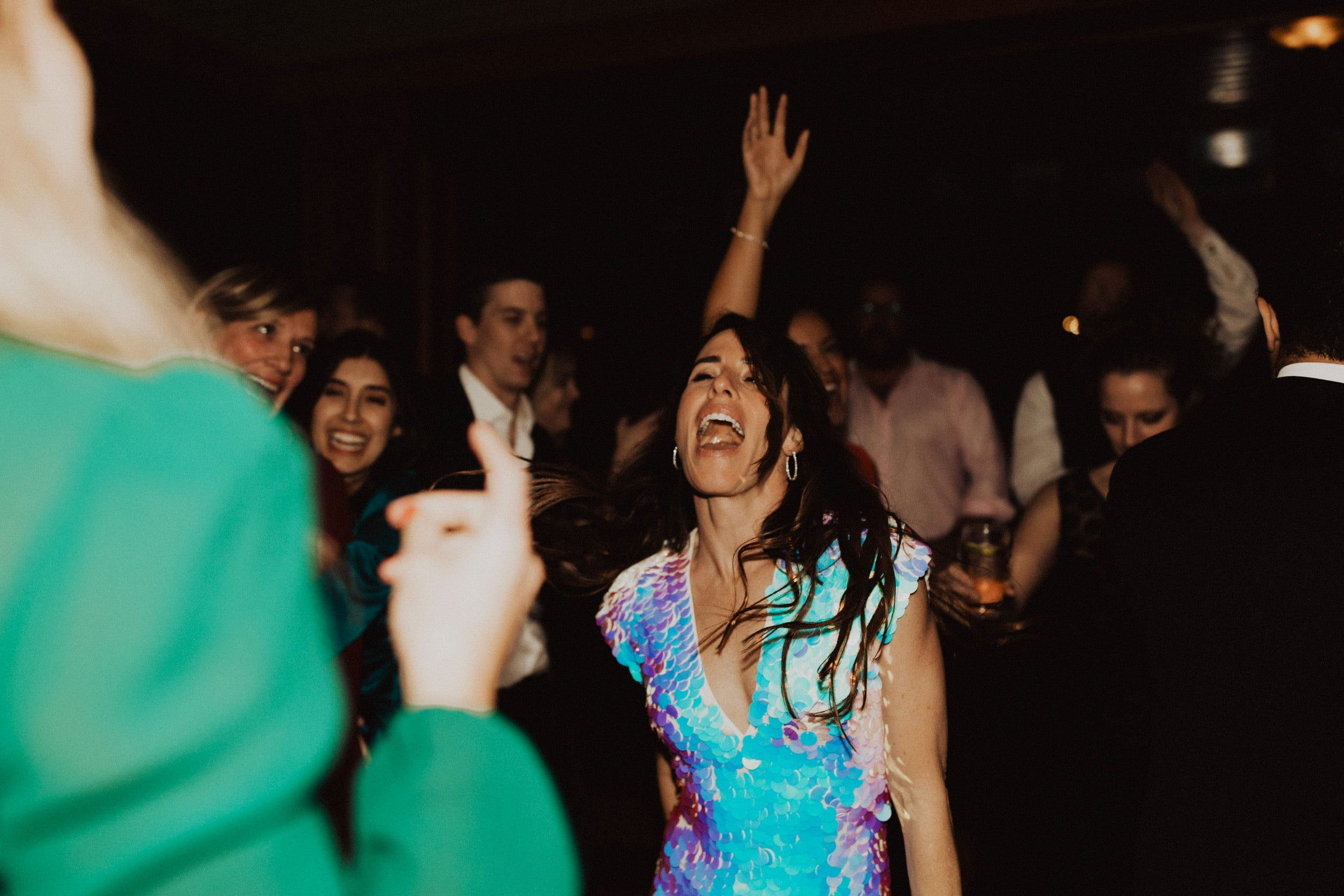 Woman sings on while on the dance floor at her wedding