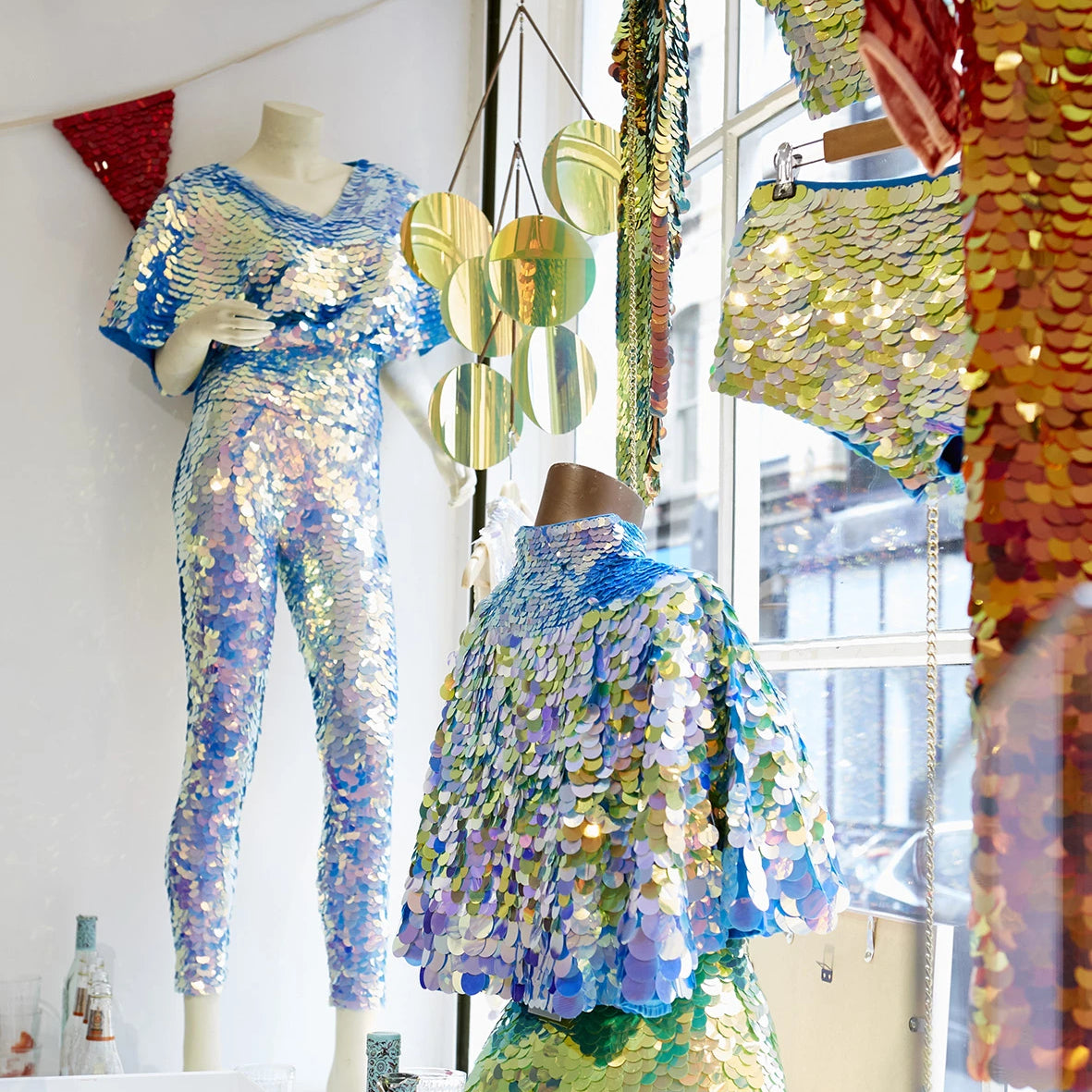 Sequin clothing display in a shop window