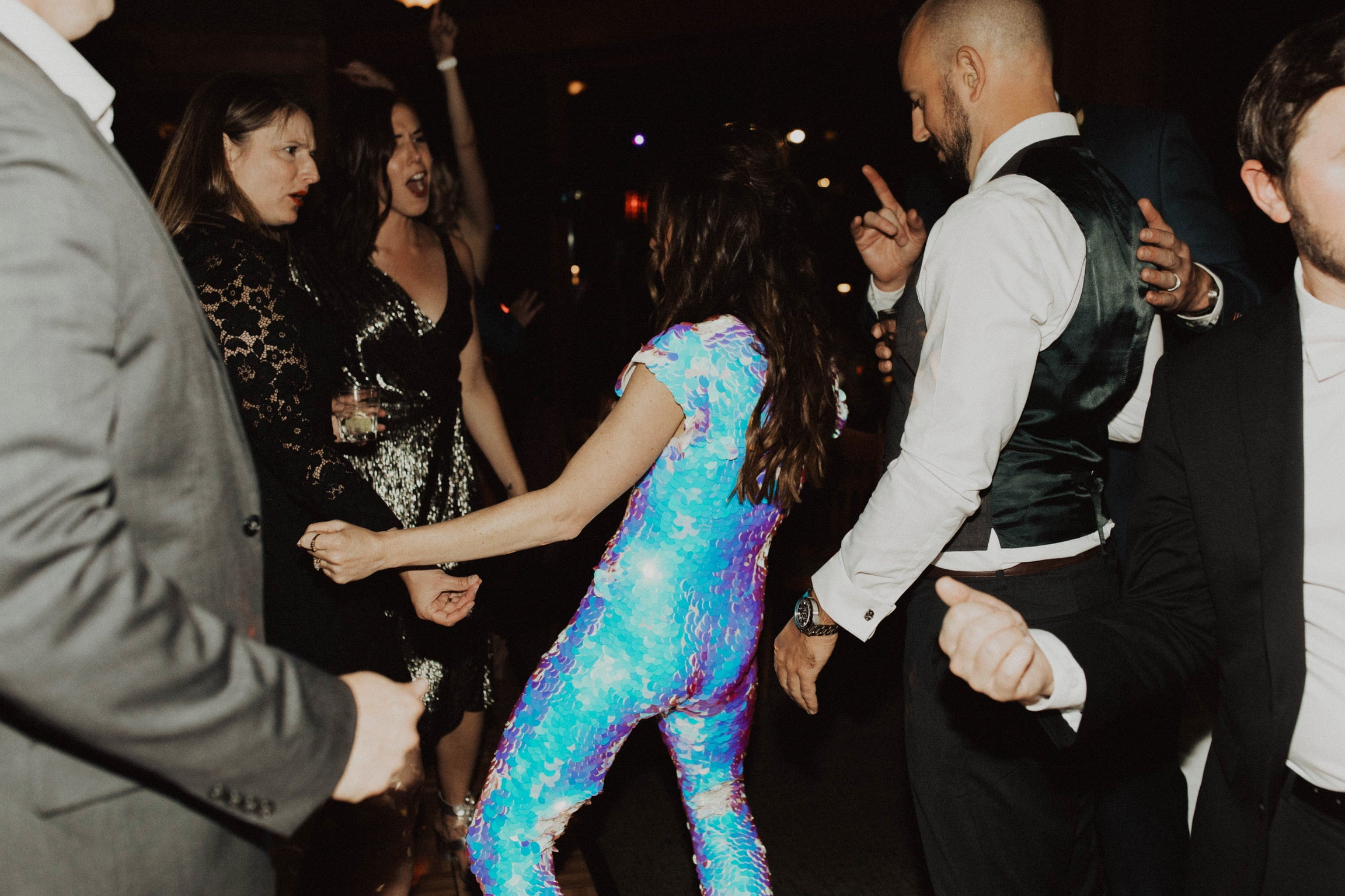 Woman wears a sequin jumpsuit to her wedding