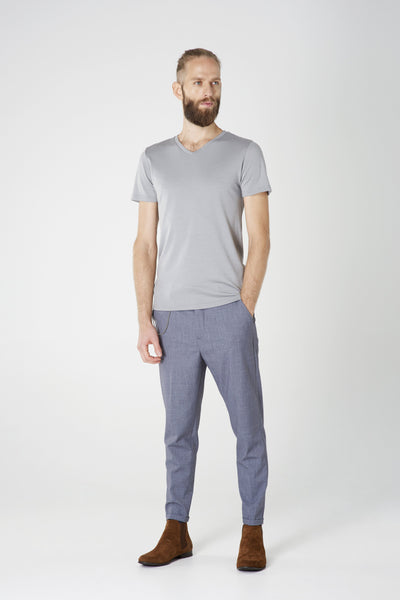 Men's V-neck T-shirt in ultrafine grey merino (200gsm) by Feelwear_ model wearing t-shirt and trousers