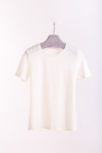 Women's o-neck T-shirt in midweight ivory merino (200gsm) by Feelwear_ on hanger