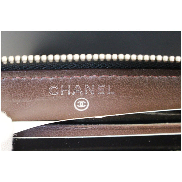 Chanel Wallet Lambskin Chevron Quilted Zip - chanel logo