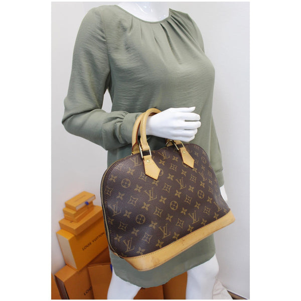 Louis Vuitton Alma Monogram Canvas Satchel Bag Brown for women