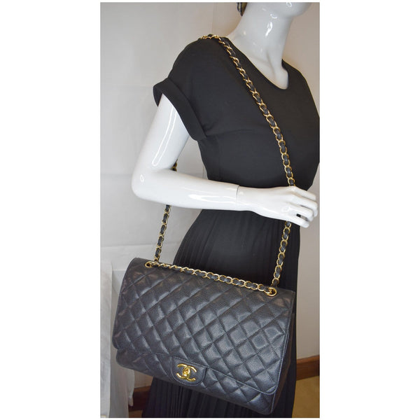 CHANEL Maxi Double Flap Caviar Leather Shoulder Bag Black