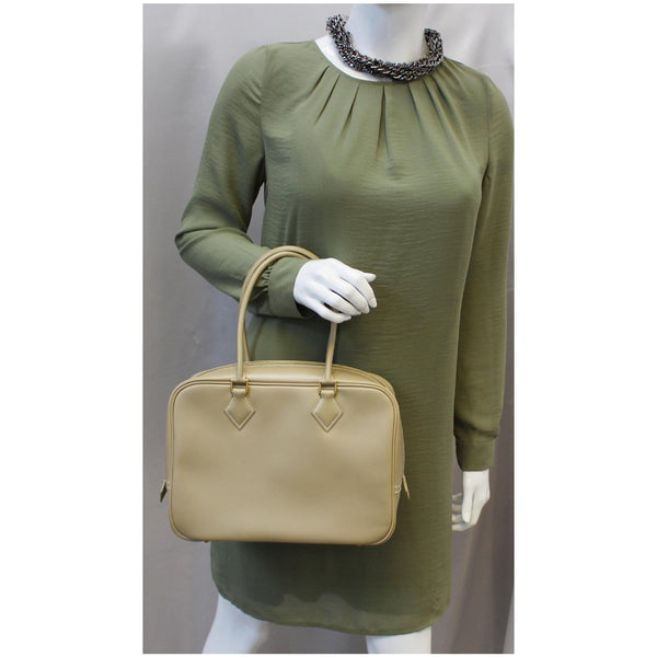 Woman holding Hermes Plume Swift Calfskin Leather Bag