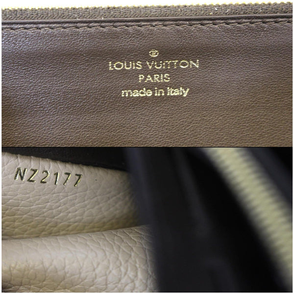 Louis Vuitton Capucines Wallet - logo