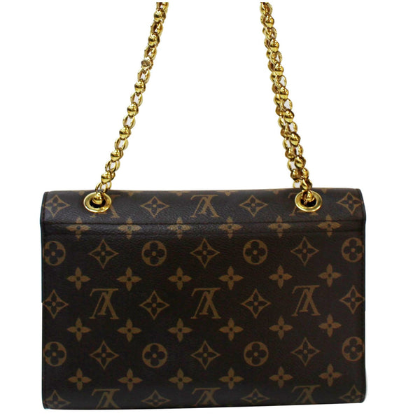 Brown color Louis Vuitton Victoire Monogram Canvas Bag
