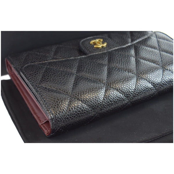 Chanel Large Flap Quilted Caviar Leather Wallet logo on front